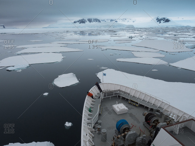 A ship breaks through the fast ice in search of Adventure. Antarctica.