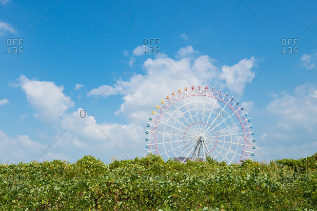 Carnival ferris wheel with clear sky.
