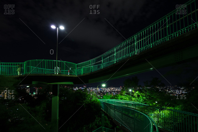 Kobe, Japan - August 30, 2016: Night view of Venus bridge and Kobe cityscape.