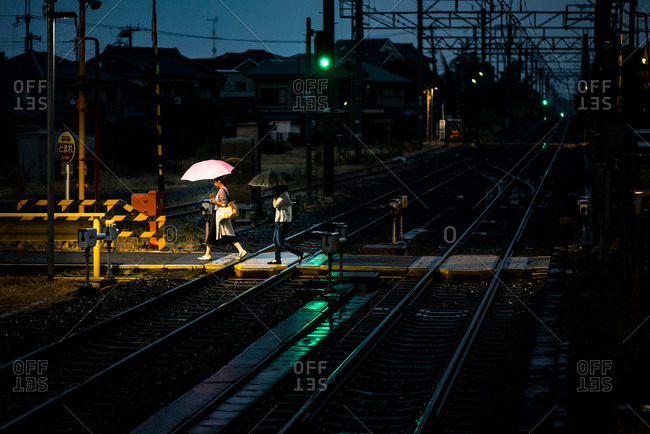 Osaka, JAPAN - September 3, 2016: Rainy walk on tracks.