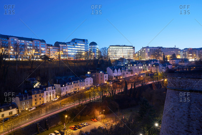 Luxembourg City, Luxembourg - January 16, 2017: City buildings above residential homes at night in Luxembourg City