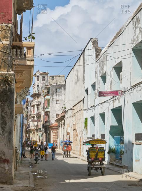 Havana, Cuba - March 4, 2017: Street scene with bike taxis in Havana, Cuba