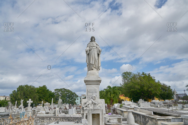 Havana, Cuba - March 5, 2017: Jesus sculpture on grave in the Colon Cemetery, Havana