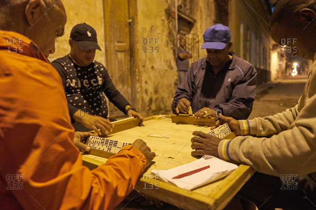 Havana, Cuba - March 5, 2017: Men playing game of dominoes in an alley