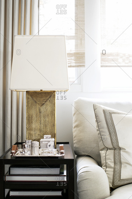West Hollywood, California, USA - May 5, 2015: Modern lamp on end table in condo living room