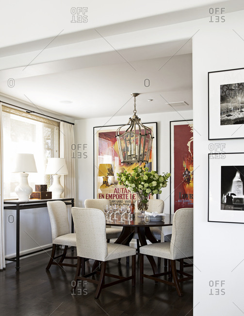 West Hollywood, California, USA - May 4, 2015: Dining area in condo with table, chairs, and movie posters