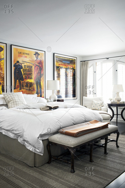 West Hollywood, California, USA - May 4, 2015: Interior of bedroom in condo with movie posters on wall