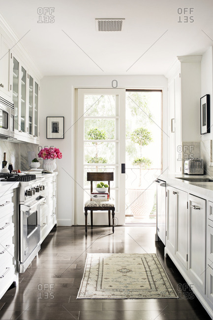 West Hollywood, California, USA - May 5, 2015: Bright, white kitchen in condo