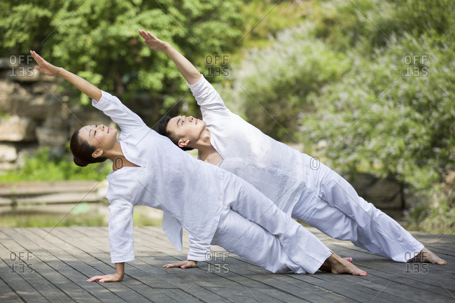 Young adult practicing yoga - Offset