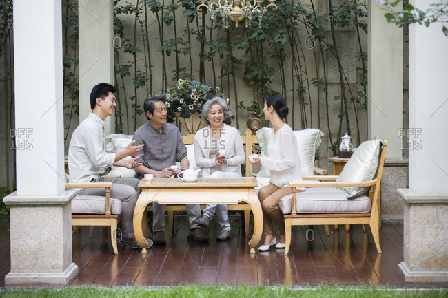 Happy family drinking tea together