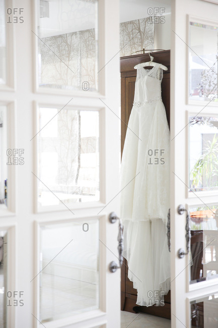 Wedding dress hanging from furniture
