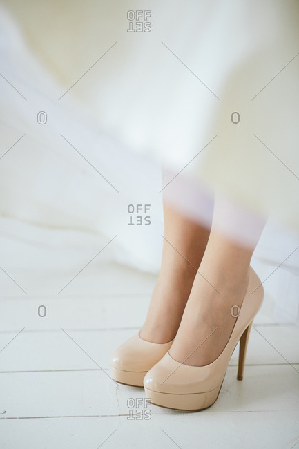 Close-up of bride's beige stiletto pumps