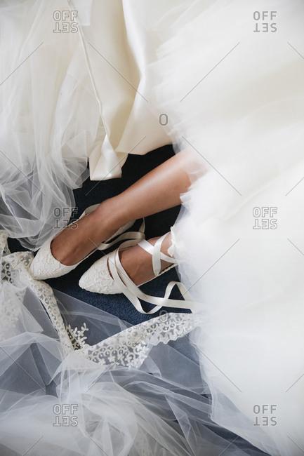 Overhead view of bride tying her ballerina flats