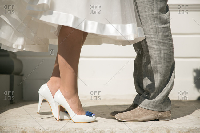 Close-up of bride and groom's footwear
