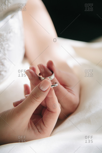 Bride holding two wedding rings