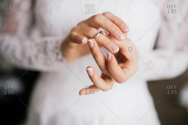 Bride putting on wedding band