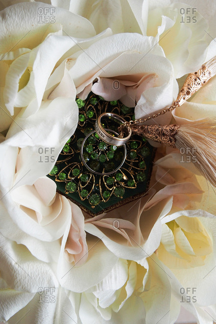 Overhead view of ornate wedding ring pillow