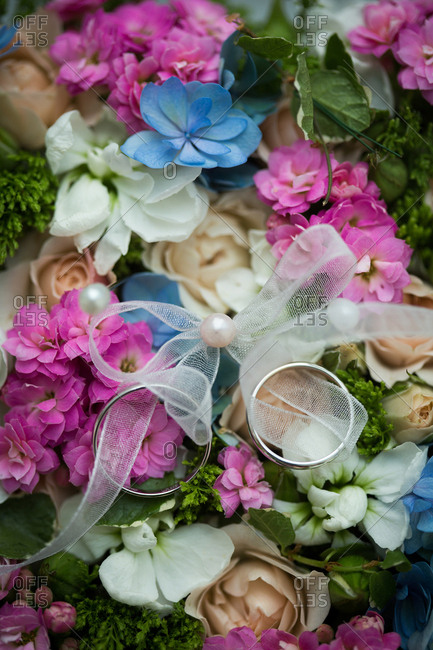 Wedding bands on flowers