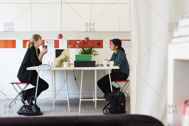 Side view office set Black Silhouettes Side View Of Mid Adult Businesswoman Talking At Table In Office Stock Photo Offset Offset By Shutterstock Side View Of Mid Adult Businesswoman Talking At Table In Office