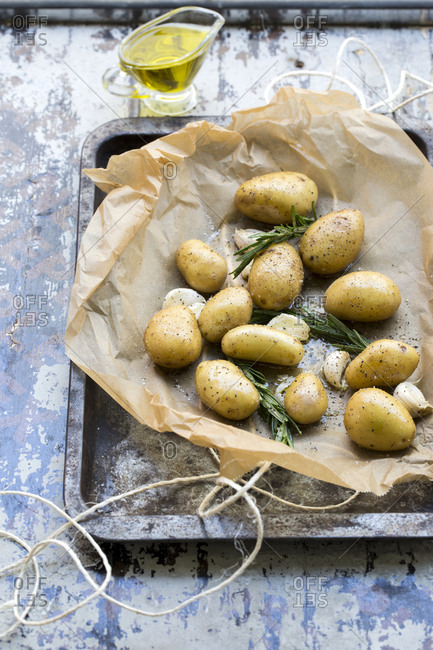 Baby potato parcel on a baking tray