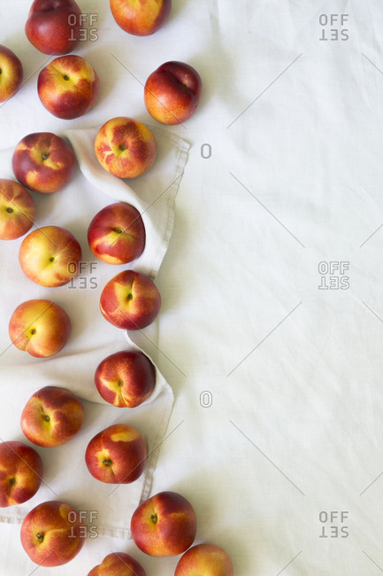 Overhead view of nectarines on a white cloth