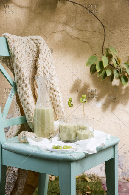 Kiwi smoothies served on a wooden chair
