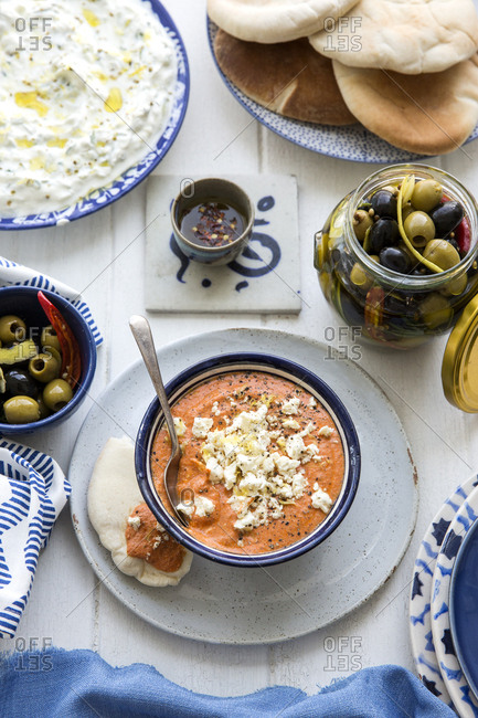 Greek meal served on white wooden table