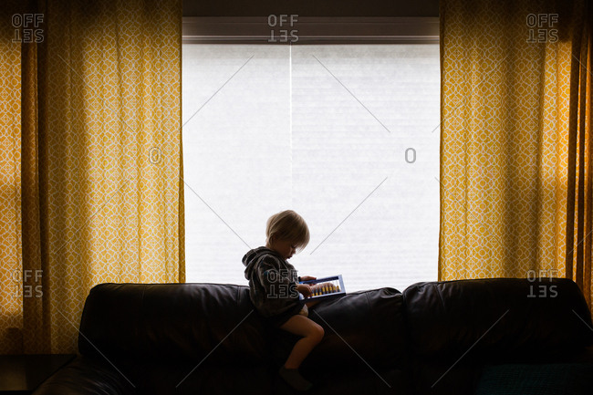 Child with counting toy on couch