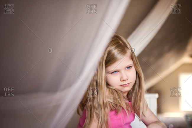 Child with blue eyes staring off