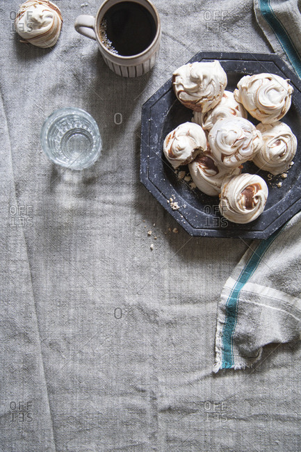 Chocolate and white meringue swirls on a plate