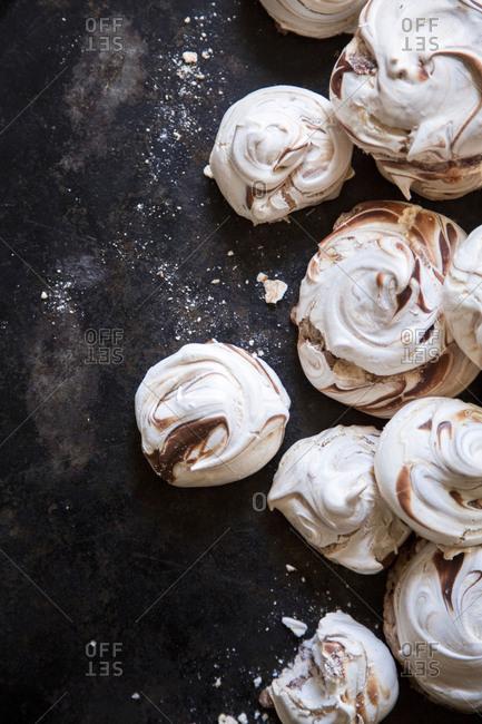 Chocolate and white meringue swirls and crumbs