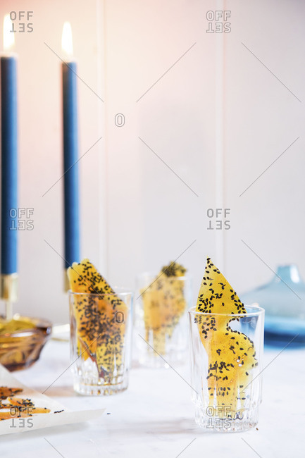 Sugar glass with black sesame seeds in serving cups