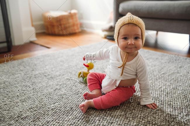 Baby in a knit bonnet