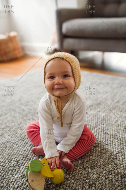 Baby wearing a knit bonnet