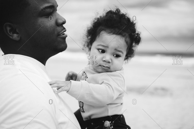 Father holding his baby son in his arms