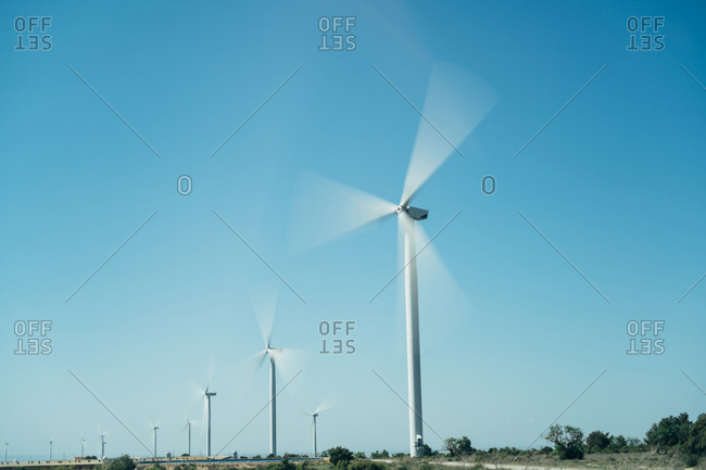 Wind turbines turning in a rural field