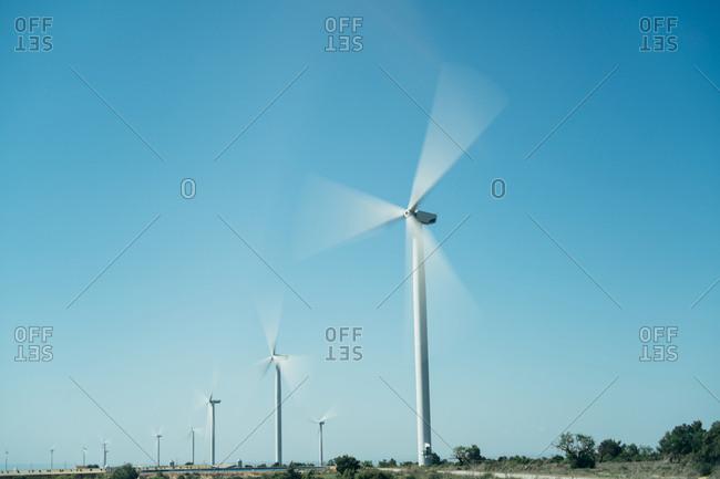Wind turbines turning in a rural field