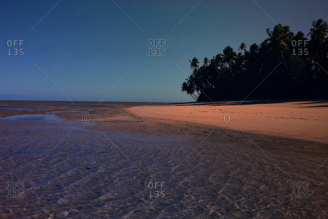 Shallow rippling water on a tropical beach