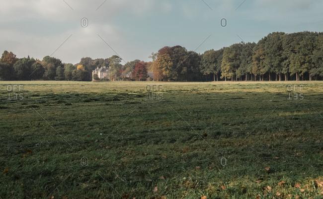 Mansion in Dutch rural landscape between autumn trees.