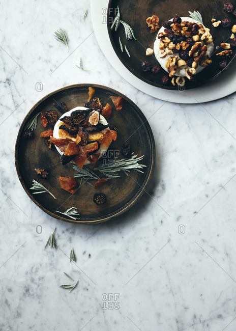 Plates of cheese with dried fruits and nuts