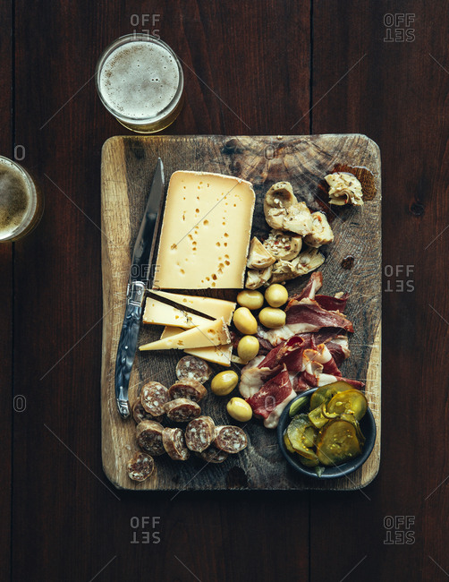 Antipasto prepared on a wooden cutting board