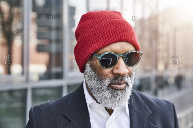 Mature businessman wearing red cap