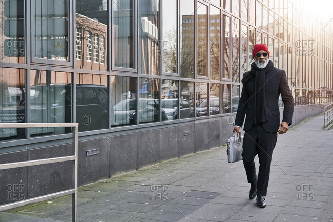 Mature businessman walking in the street