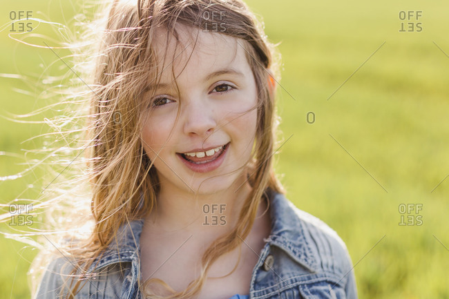 Portrait of smiling girl with blowing hair
