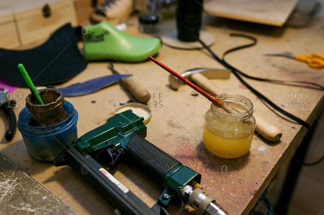 Shoemaker's utensils in workshop