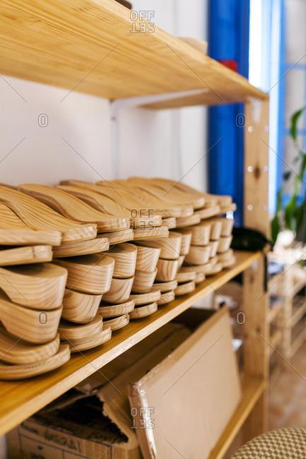 Shoe lasts on shelf in shoemaker's workshop