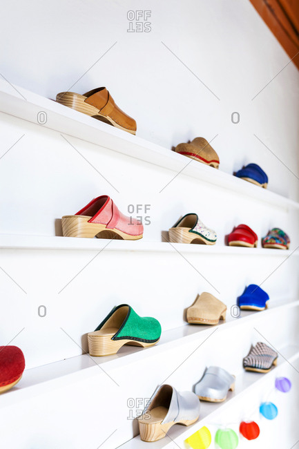 Assortment of clogs on shelf