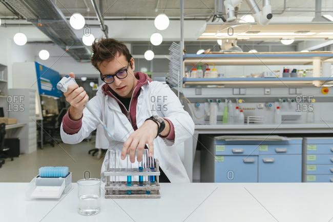 Laboratory technician taking samples in lab
