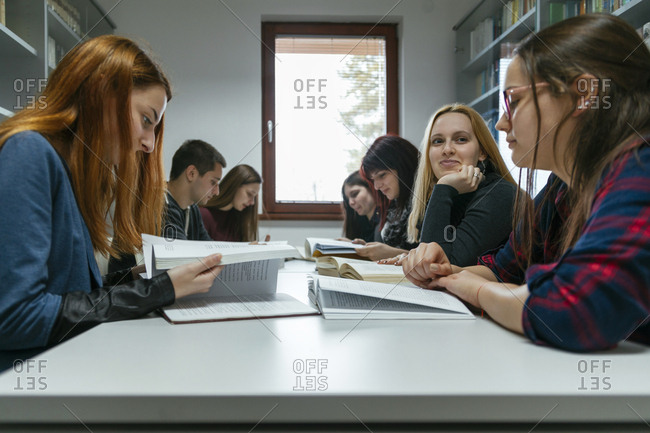 Group of students learning together in a library
