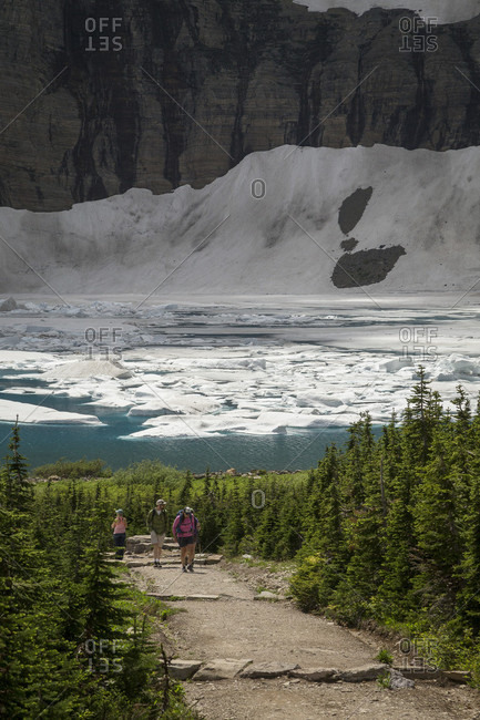 Glacier National Park, Montana, USA - July 26, 2014: The reward of hiking the five mile, out and back,  trail to Iceberg Lake is a mountain lake that is covered in icebergs lake into the year.